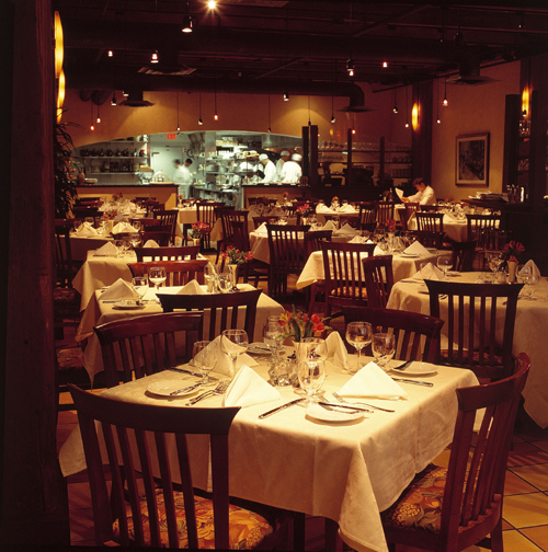 The warm interior of Cioppino's looking into Pino's state of the art kitchen