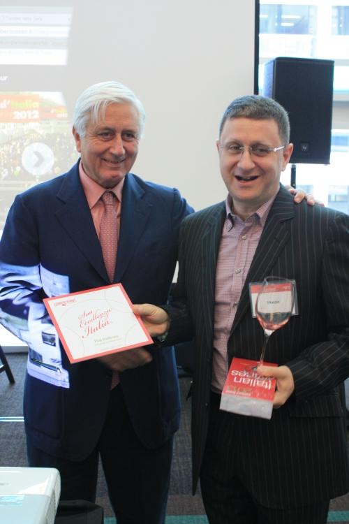 GIGI SALERNO CEO OF GAMBERO ROSSO PRESENTING CHEF PINO WITH THE AWARD PLAQUE
